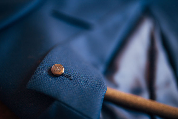Close-up of button on blazer