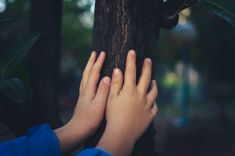 Bonding Close-up EyeEm Team Focus On Foreground Hugging Human Body Part Human Hand Leisure Activity Low Section Nature Orchard Outdoors Real People Touching Tree Tree Trunk מייעמית TCPM Shades Of Winter