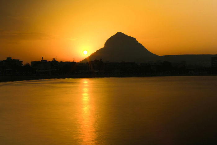 Sunset over Montgo, Javea Javea Mountain No People Pauldroberts Scenics Silhouette Sky Sun Sunset Tranquil Scene Travel Destinations Water Xabia Sommergefühle Paint The Town Yellow