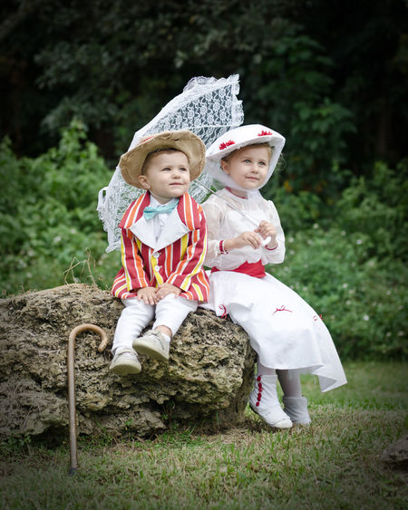 Child Childhood Children Only Costumes Cute Day Friendship Full Length Happiness Mary Poppins Nature Outdoors People Portrait Real People Sitting Smiling Togetherness Tree