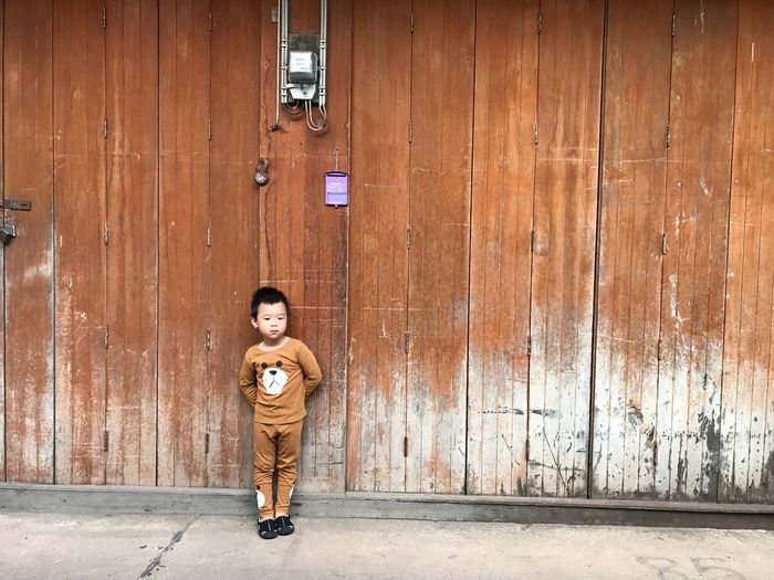 One Person Full Length Childhood Architecture Child Standing Casual Clothing Wall - Building Feature Arts Culture And Entertainment Real People Boys Men Leisure Activity Lifestyles City Offspring Males  Day Front View Outdoors
