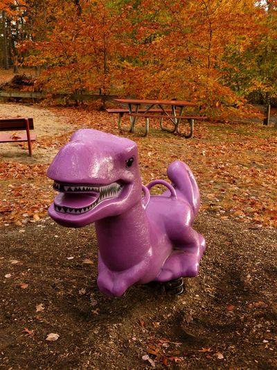 BARNEY Autumn The Week On EyeEm Autumn Carousel Childhood Close-up Day Dinasaur Leaf Nature No People Outdoor Play Equipment Outdoors Park - Man Made Space Park View Pink Color Playground Playground Slide Purple People Eater Tree