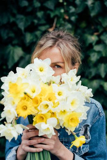 Portrait of woman holding flower bouquet