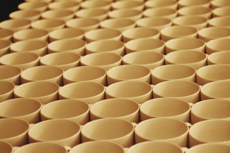 Full frame shot of bowls arranged on table