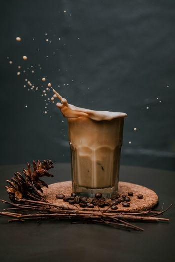 Close-Up Of Coffee Splashing In Glass