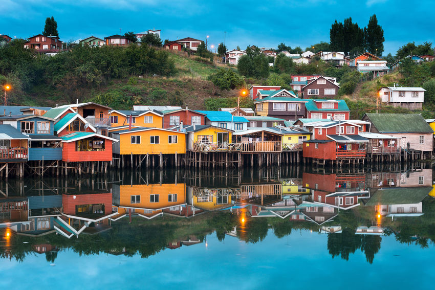 Traditional stilt houses know as palafitos in the city of Castro at Chiloe Island in Southern Chile Chile Chilean  Chiloé, Chile Cityscape Latin America Palafitos TOWNSCAPE Architecture Building Exterior Built Structure Castro Chiloe Chile Chiloe Island Chilöe City House Latin American Multi Colored Reflection Residential District Stilt House Traditional Water Waterfront