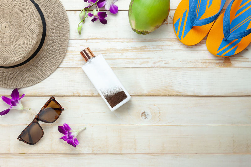 Container Directly Above Fashion Flower Flowering Plant Food And Drink Freshness Glasses Hat High Angle View Indoors  No People Personal Accessory Plant Purple Sandal Shoe Still Life Sunglasses Table Wood - Material