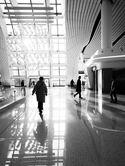 People walking in modern building