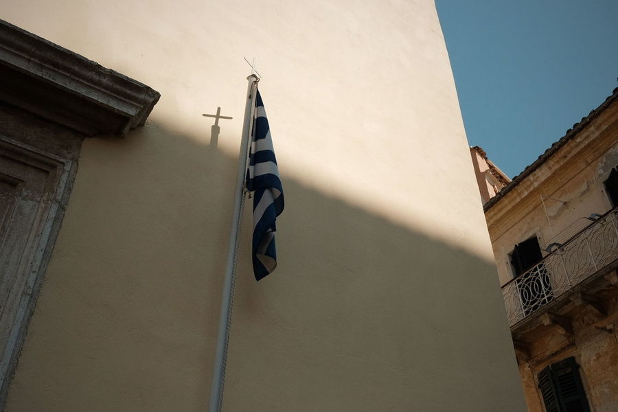 Holiday Vacation Hot Day Flag Greece Eye4photography  EyeEm Selects EyeEm Gallery Nature Nature_collection Sun Sunlight Sunlight And Shadow Light And Shadow Beauty In Nature Summer Streetphotography Street Urban Urban Exploration History Sky Architecture Building Exterior Built Structure Old Town TOWNSCAPE Town Square Place Of Interest Civilization