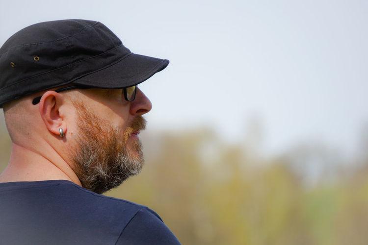 Close-up of man wearing cap