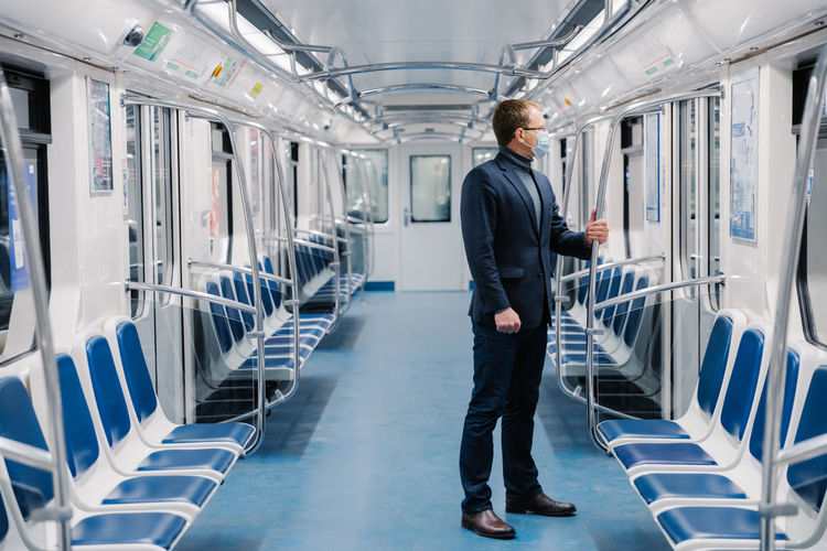 Businessman standing in empty train