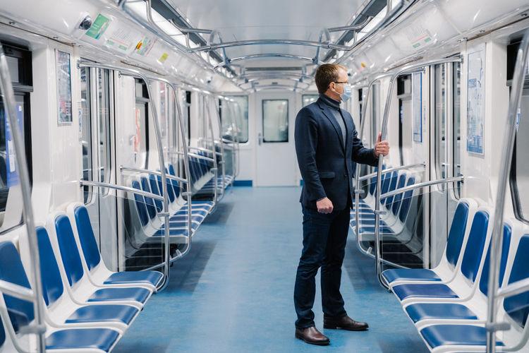Businessman standing in empty train