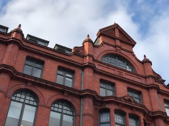 Red brick building in Manchester EyeEm Selects Low Angle View Building Exterior Architecture Sky Built Structure Cloud - Sky Window Building No People Day Arch The Past Outdoors History Old City Travel Destinations Façade Travel