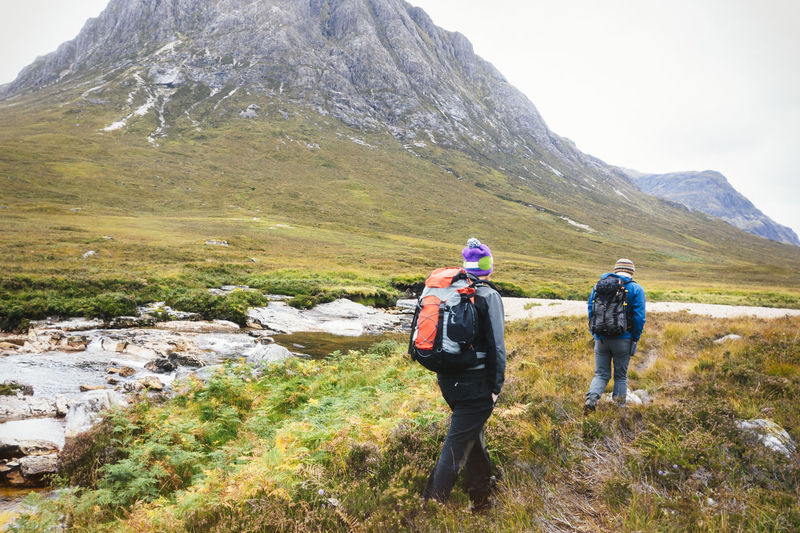 Approach Glencoe Scotland Vacations Adventure Backpack Beauty In Nature Friendship Healthy Lifestyle Hiker Hiking Landscape Leisure Activity Lifestyles Men Mountain Nature Outdoors Real People Togetherness Travel Destinations Two People Walking Wild Wilderness