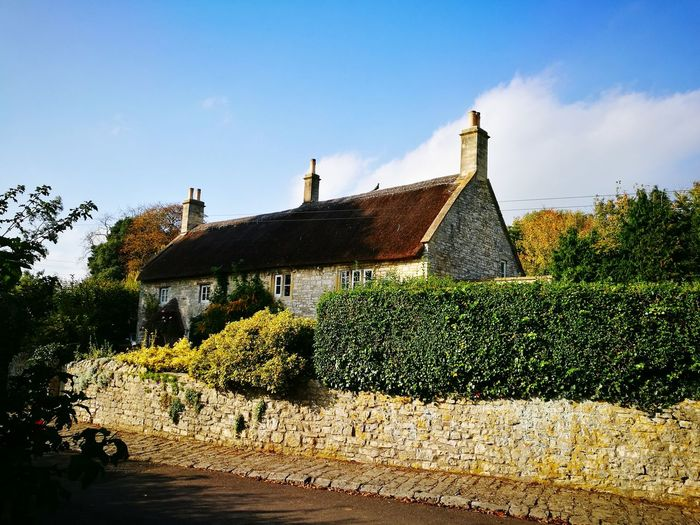 Outdoors Architecture Sky No People Day Tree Cotswold Cottage Village Cotswold Stone Building Exterior Architecture Cottage Garden  Hedgerow Quaint Cottage