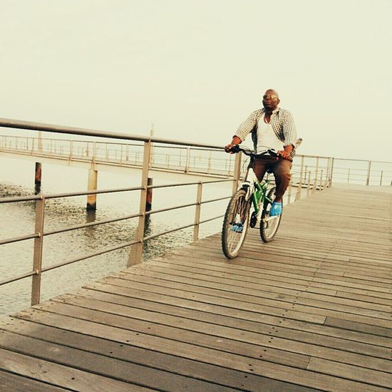 A ride by the river. Lisbon Man Summer Rx100