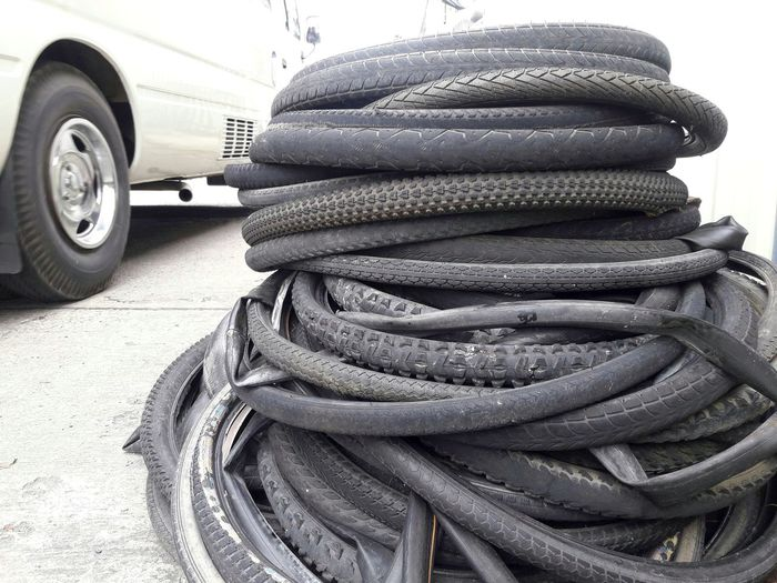 pile of old tire Pile Stack Of Tires Technician Black Bicycle Repairman Garage Deteriorate Change Tires Cement Floor Daytime Old Tire Tire Bike Stack Close-up