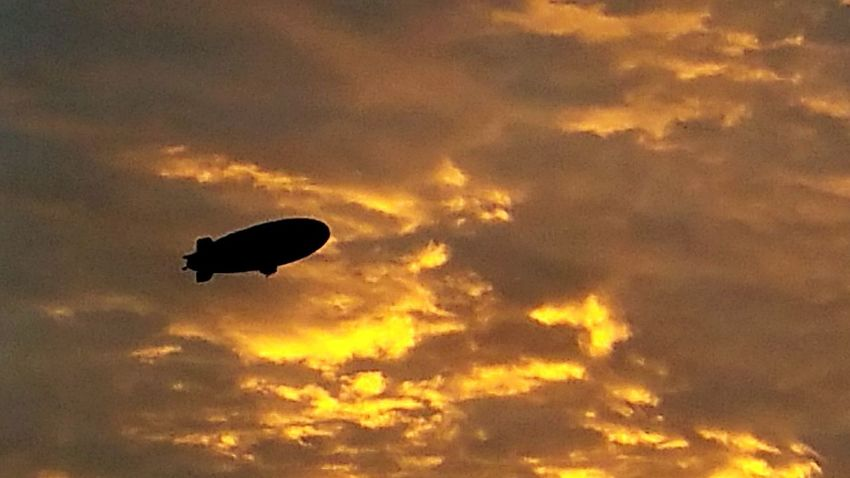 I took this outside of my work. Thought the sunset was looking pretty awesome that night and then in the distance I notice the blimp just slowly cruising by. Sunset Cloud - Sky Southern California Orangeclouds Blimp In The Sky Blimp Southern California Sunset Firesky November Night Flying