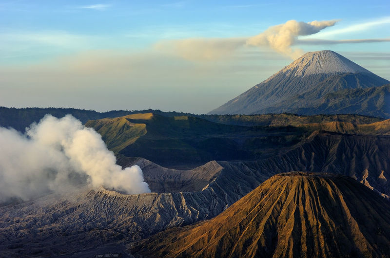 Barren Bromo Mountain Burning Extreme Terrain Flame Geology Landscape Majestic Mountain Mountain Peak Mountain Range Non-urban Scene Outdoors Physical Geography Power In Nature Remote Scenics Tranquil Scene Weather