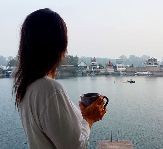 Lake Thoughts Contemplation. Morning Creative Space Water Sky One Person Built Structure Architecture Building Exterior Creative Space Nature Rear View Real People Outdoors Nautical Vessel Day Casual Clothing