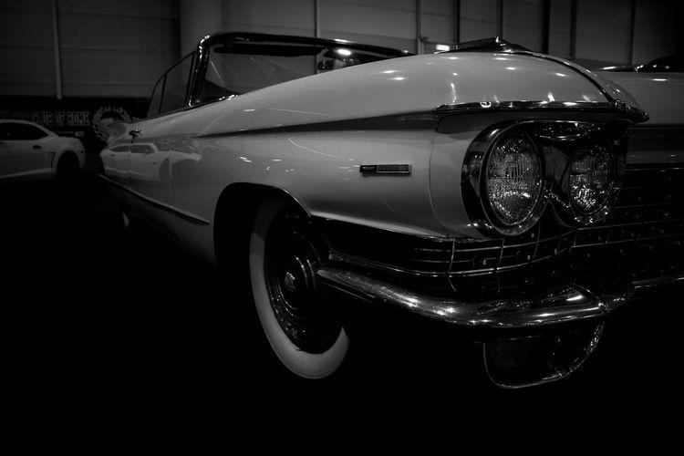 Close-up of vintage car on street