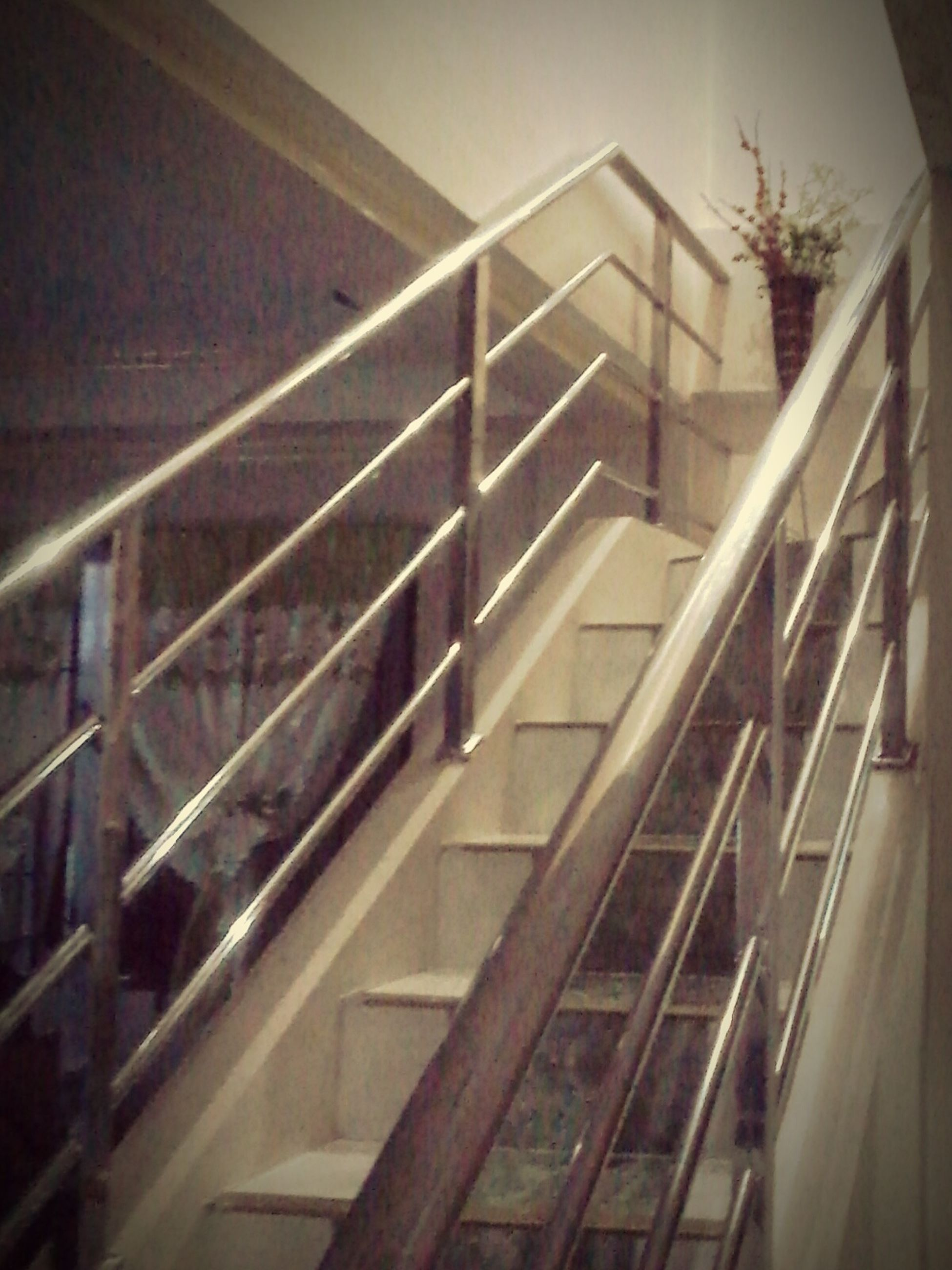 railing, staircase, steps and staircases, steps, built structure, architecture, low angle view, indoors, building, building exterior, metal, no people, connection, high angle view, day, stairs, bridge - man made structure, sunlight, balcony, escalator