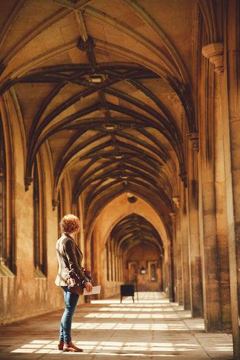 Woman Standing In Corridor At Church