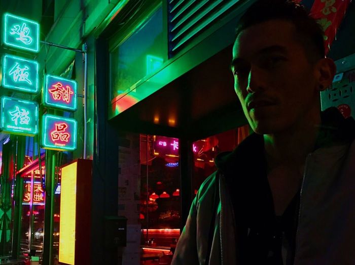 neonlights Illuminated Real People Lifestyles Neon One Person Leisure Activity Night Standing Indoors  Young Adult People Nightlife Strong Millennials One Man Only