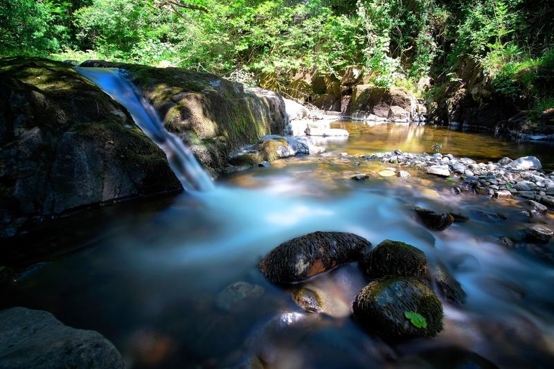 Aire Force, Ullswater Ullswater Wide Angle Waterfall Long Exposure Cumbria Lake District Aire Force Water Nature Rock Beauty In Nature No People Day Scenics - Nature Rock - Object Tranquility Motion Shallow Sunlight Flowing Water River Outdoors The Great Outdoors - 2018 EyeEm Awards