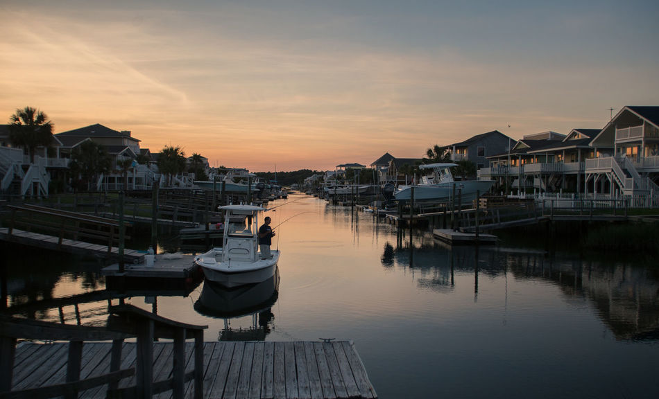 Amber Exploring EyeEmNewHere Horizontal Summertime Adventure Beach Boardwalk Candid Photography Fishing Fishing Boat Harbor Nautical Vessel Reflection Sea Still Water Summer Sunset Tranquil Scene Tranquil Scene Outdoors Warm Colors Water Waterfront