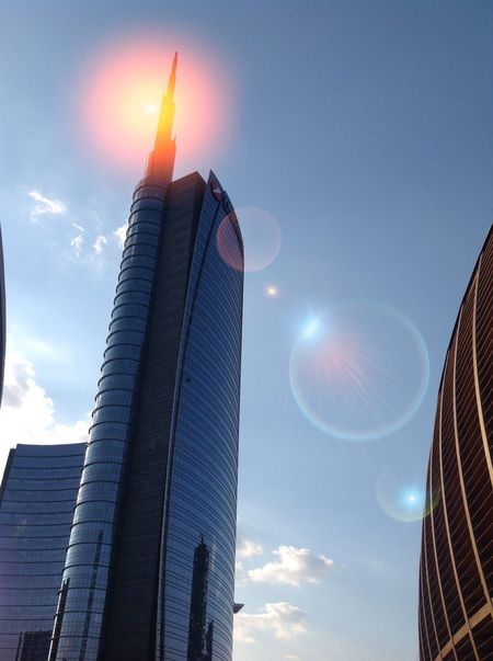 Ray of light Low Angle View Architecture Building Exterior Built Structure Tower City No People Sky Outdoors Skyscraper Illuminated Modern Sun Day Unicredit Tower Gae Aulenti Silhouette Sunset Travel Destinations Milan Fashion Week Milan,Italy Milanocity