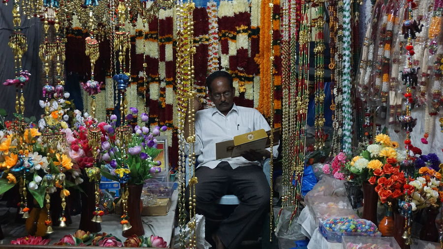 A Shopkeeper with a Wedding ⚭ Invitation Card in his Hands. Men Multi Colored One Person Only Men Real People One Man Only Adults Only Adult People Outdoors Day Wedding Card Indian Marriage Sony A6000 SonyAlpha6000 Nwin Photography
