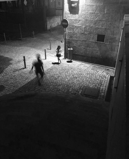 High angle view of people walking on street at night