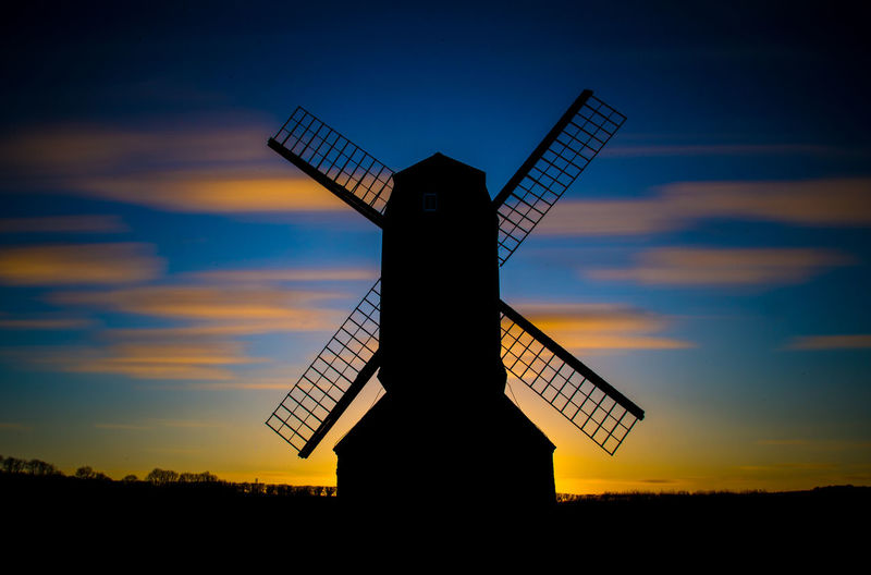 Windy Silhouette Architecture Built Structure Dusk Colours Environmental Conservation Industrial Windmill No People Outdoors Silhouette Sky Sunset Traditional Windmill Wind Power Windmill EyeEmNewHere