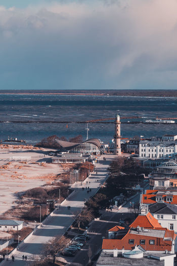 Warnemünde Rostock Promenade Building Exterior Architecture Built Structure Sky Building Cityscape Cloud - Sky City Water High Angle View Horizon Nature Sea No People Residential District Day Tower Horizon Over Water Roof Outdoors Office Building Exterior Hotel Neptun