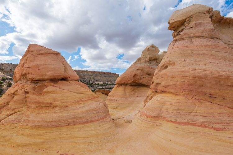 Low angle landscape large yellow striped conical rock formations at ojito wilderness in new mexico