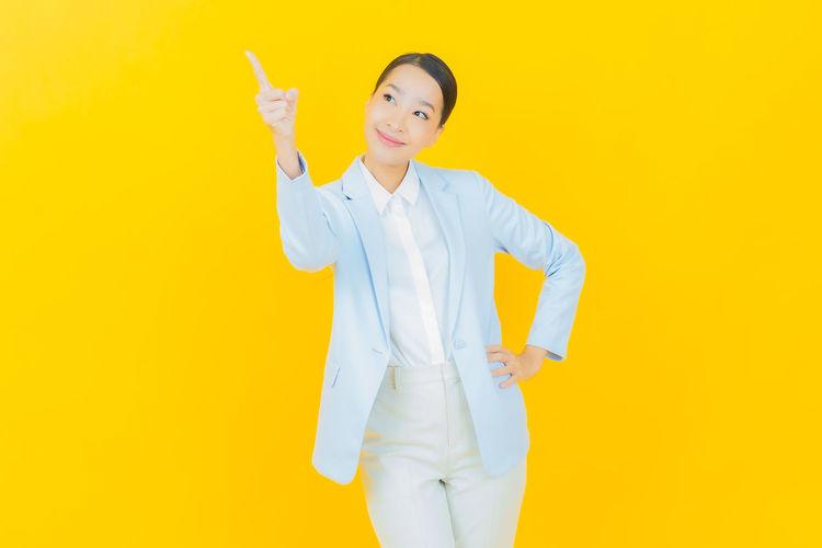 Portrait of woman holding yellow umbrella