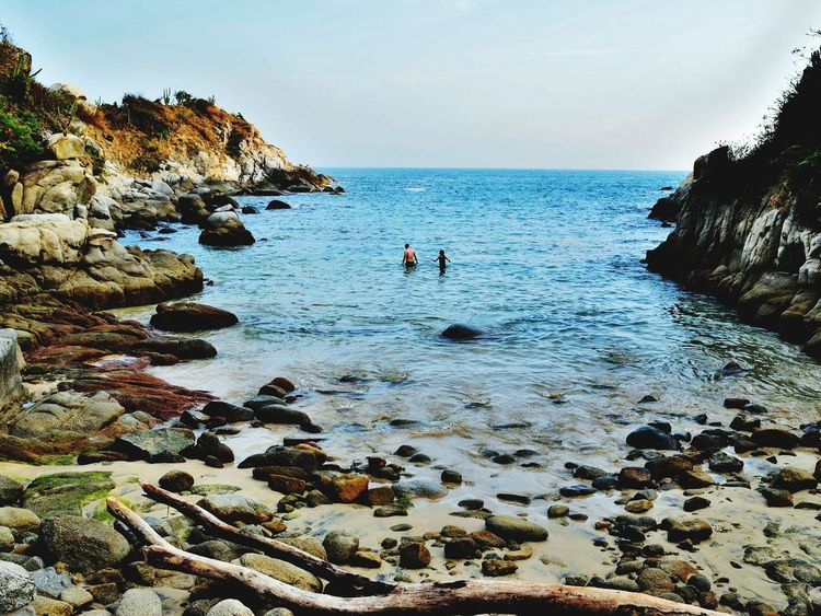 Sea Nature Beach Rock - Object Beauty In Nature Horizon Over Water Outdoors Real People Scenics Water Leisure Activity Togetherness People Women Adult Day Sky Adults Only