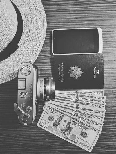 Preparation before traveling Black And White Camera Vintage Camera Money Cash Dollars Bank Notes USA American USD Traveler Traveling Preparing For Trip Travel Travel Photography Passport Flat Lay