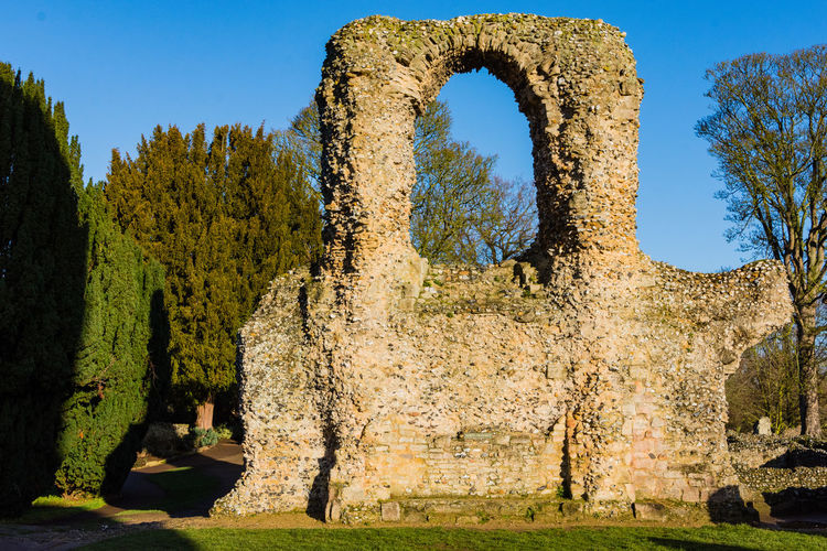 A part of the ruined abbey to be found in The Abbey Gardens, Bury St Edmunds. Photo taken on a cold winter morning. Abbey Gardens Bury St Edmunds History Ancient The Past Old Ruin Architecture Travel Destinations Old Buildings Gardens Public Space Sunlight Winter Day Blue Sky Cold Morning Tourism Travel Ruined Archaeology Window Window Frame