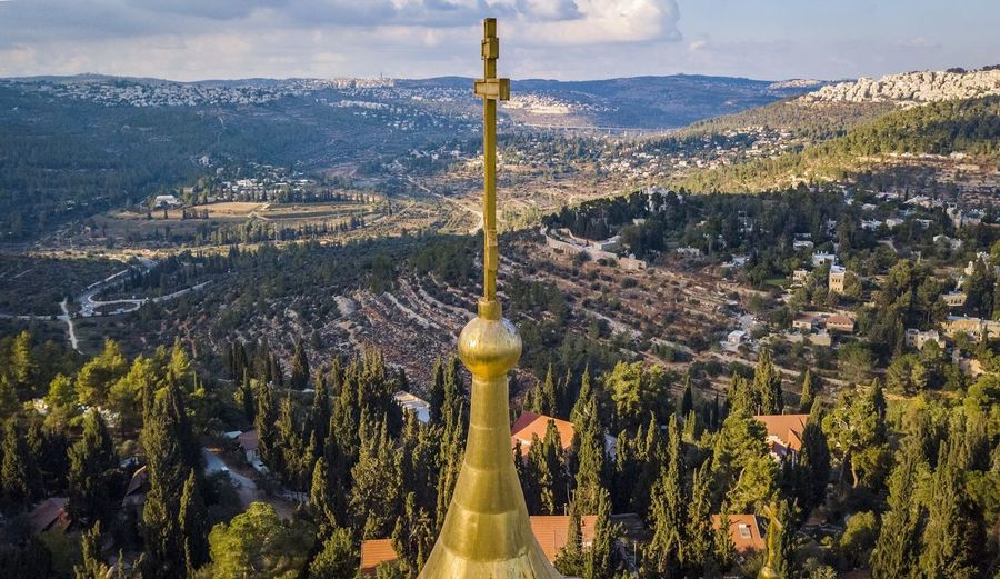 View Of Religious Cross Against Scenery