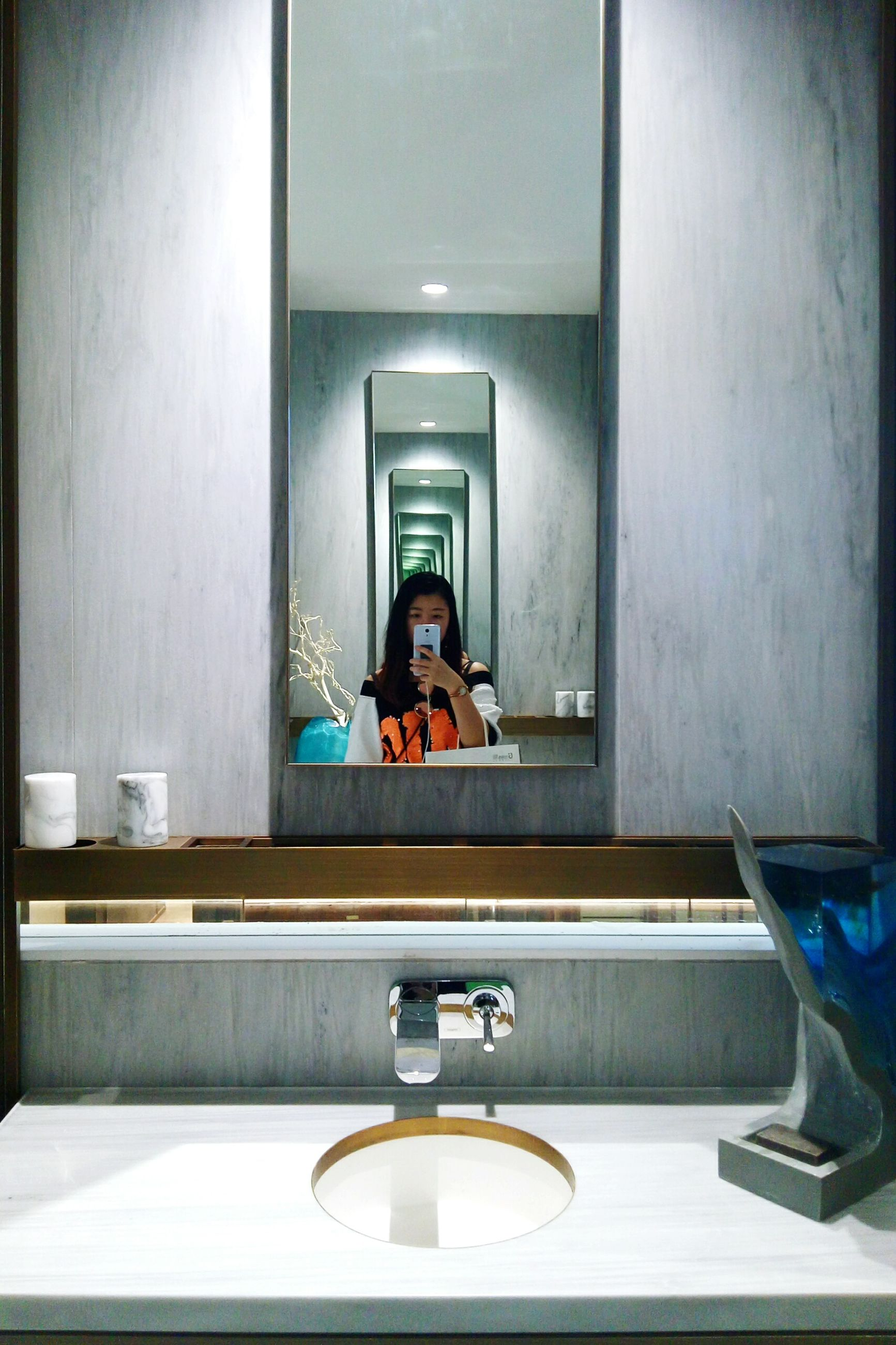 mirror, indoors, real people, bathroom, one person, illuminated, day, bathroom sink, people