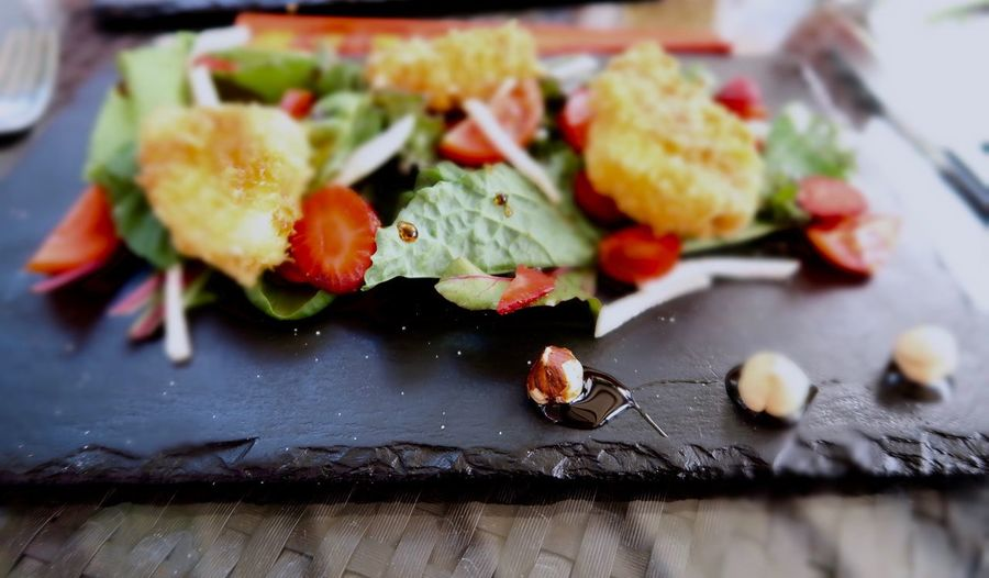 High angle view of salad on slate on table