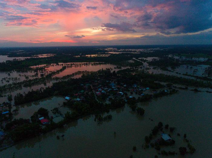 Water flood at Sakon Nakhon, Thailand Sky Cloud - Sky Sunset Water Scenics - Nature Tranquil Scene Beauty In Nature Tranquility Reflection Nature No People Aerial View Outdoors Lake Idyllic City Environment High Angle View Architecture Cityscape