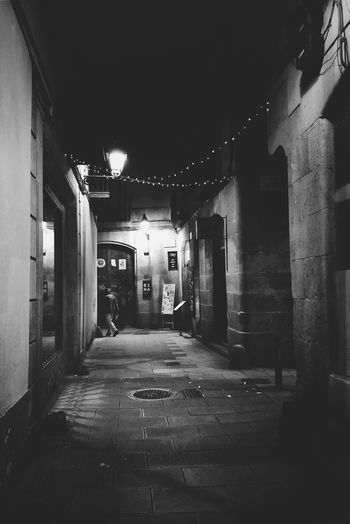 The Street Photographer - 2018 EyeEm Awards Architecture Night Building Exterior The Way Forward City Eye4photography  Streetphotography Urban EyeEm Best Shots Street Photography City Life Street Life Barcelona Urban Lifestyle Illuminated Alley Narrow Street Street Walking Around Men EyeEm Gallery Urban Life Streetphoto_bw Streetphoto Black & White Friday