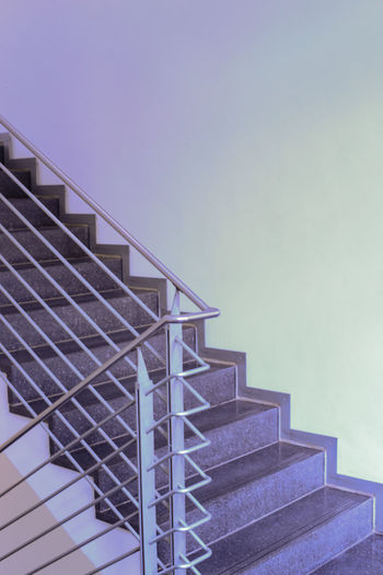 Low angle view of staircase by building against clear sky