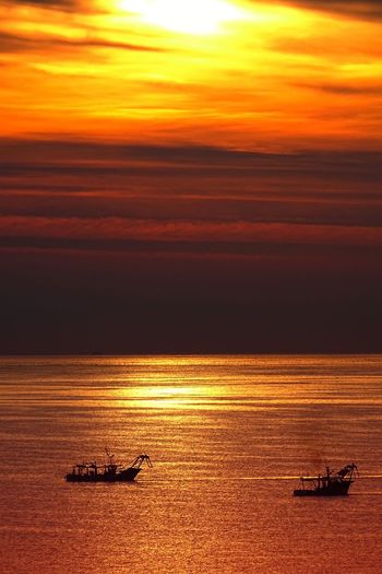 Sunrise Fishing Boat Travel Travel Destinations Sunset Transportation Sky Water Nautical Vessel Sea Mode Of Transportation Sunlight Tranquility Cloud - Sky Nature No People Scenics - Nature Tranquil Scene Sailing Beauty In Nature Travel Orange Color Ship