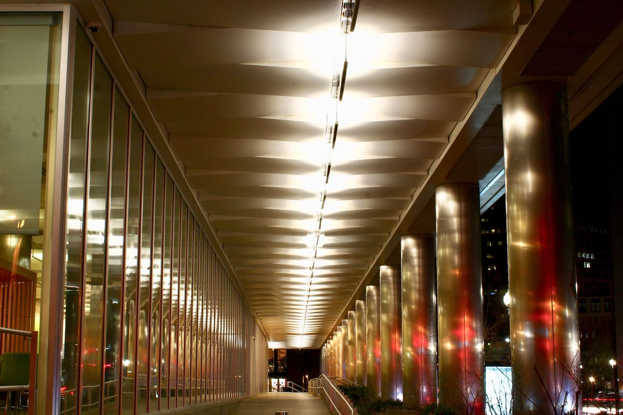 illuminated, transportation, built structure, architecture, indoors, ceiling, architectural column, rail transportation, the way forward, public transportation, train - vehicle, subway station, night, no people