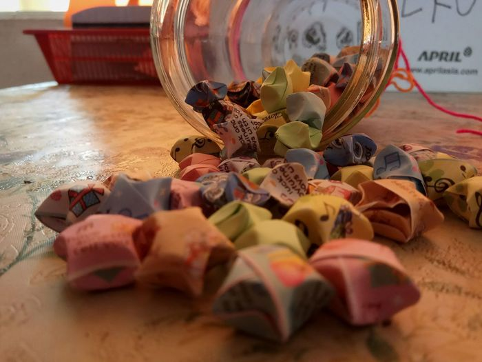 Close-up of candies in jar on table