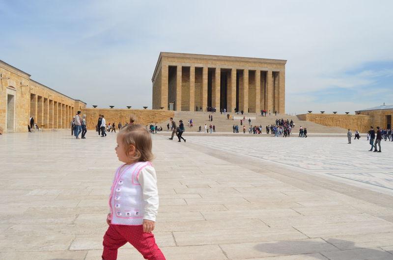 Cute girl walking at historic building